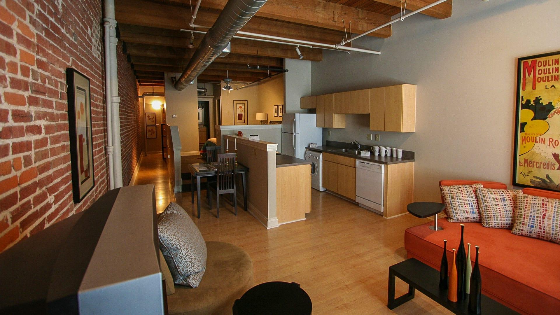 Studio Lofts With Wood Beams Brick Walls Amp Urban Views